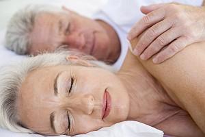 sleeping older couple